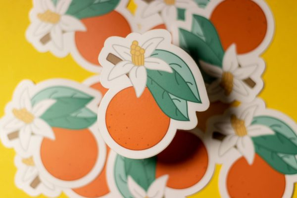 pile of orange blossom stickers