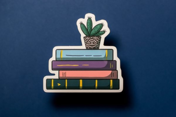 pastel stack of books on blue