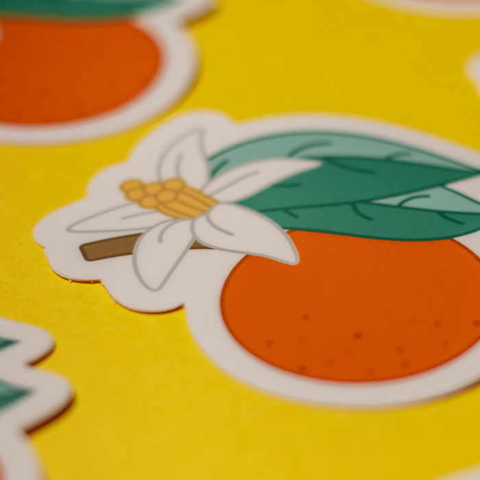 orange blossom stickers in a pattern on yellow