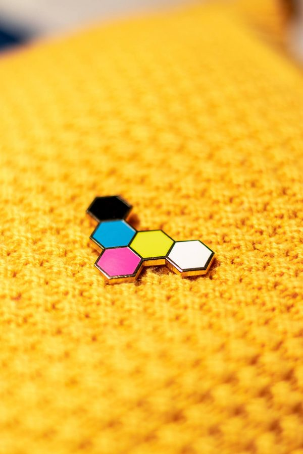 5-color hexgrid hard enamel pin on yellow knit