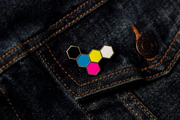 5-color hexgrid hard enamel pin on dark denim
