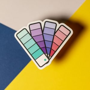 pantone fan book sticker on tri color background