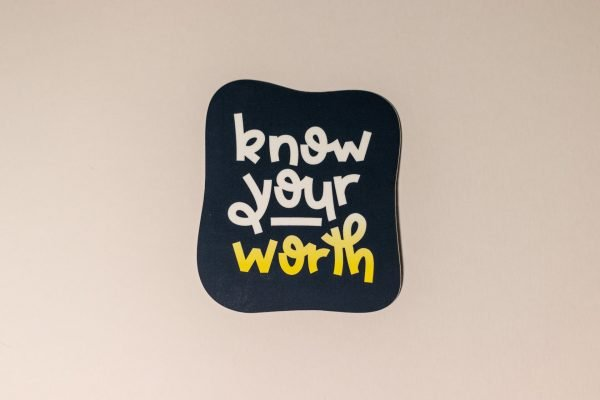 blue know your worth sticker on light background
