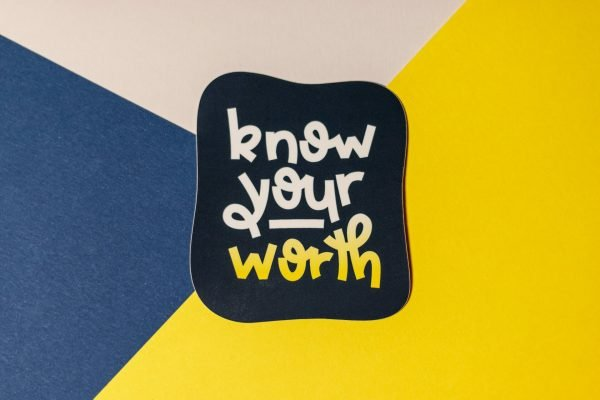 blue know your worth sticker on tri-color background