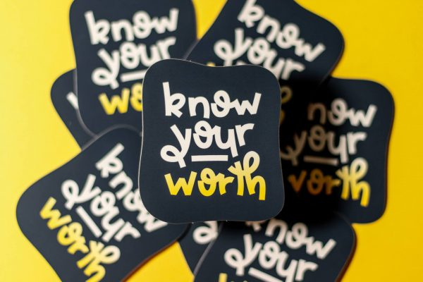 pile of know your worth stickers