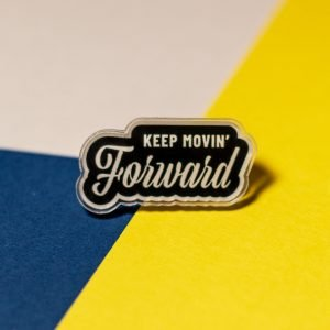 keep movin' forward acrylic pin on tri-color background